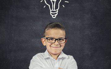 Big idea. Smart boy with solution lightbulb above head